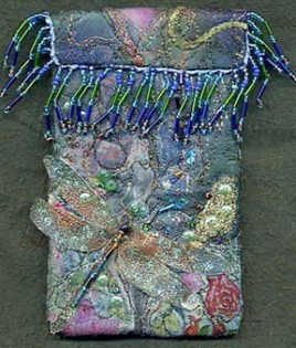 dragonfly, bondaweb fabric collage embroidered over with machine and hade stitches