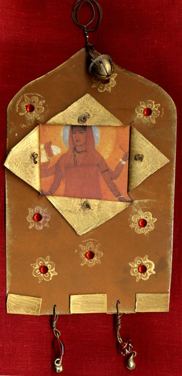 Mo Wassell, OK/ stamped on metal hanging