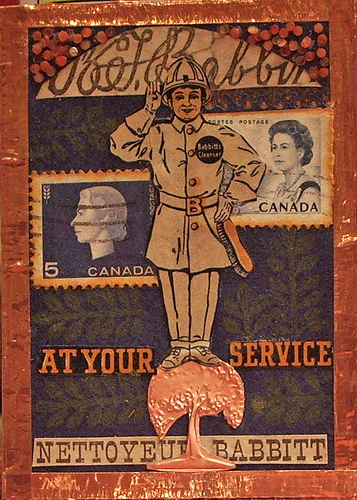 "At Your Service ATC. I cut out Babbit himself, and the ""Nettoyer Babbit"" and the ""At Your Service"" from the coupon as well. Because Babbit's is a Canadian company based out of Montreal, I added the Canadian stamps. I have one of those embossers with different discs - I embossed the tree out of some copper left over from a computer that we dismantled. I thought he looked so official standing on the tree! And because that copper was there, I got the idea to use copper tape around the edges. I filled in some spaces with tiny mosaics, and the rest with a wheat-looking stamp to complement the wheat on the Canadian stamps."