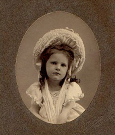 Vintage image of girl with bonnet by Darren Fleeger
