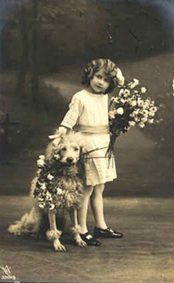 Vintage postcard, girl and a dog, sent in by Susan Frank