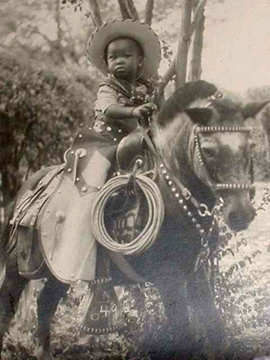 Vintage Photo, cute black boy on a pony